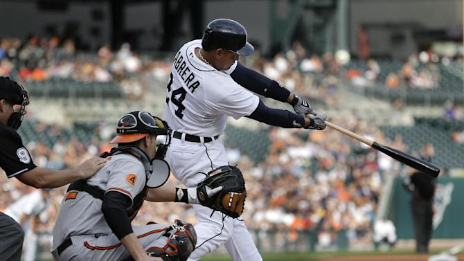 Detroit Tigers' Miguel Cabrera (24) hits a two-run home run against the Baltimore Orioles in the first inning of a baseball game in Detroit, Monday, June 17, 2013. (AP Photo/Paul Sancya)