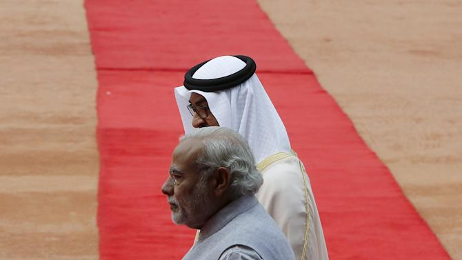 Sheikh Mohammed al-Nahyan Crown Prince of Abu Dhabi shakes hands with India's Prime Minister Modi during his ceremonial reception at the forecourt of India's Rashtrapati Bhavan presidential palace in New Delhi