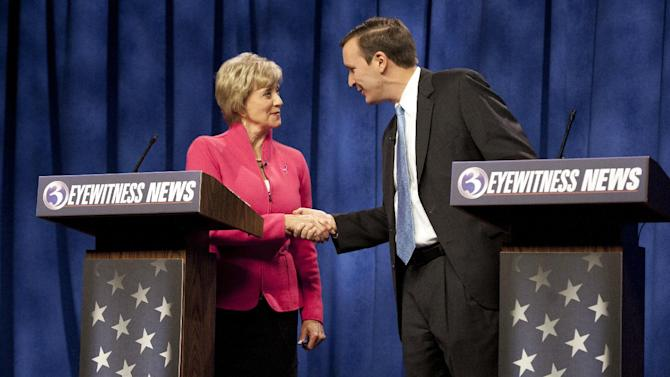 Republican candidate for U.S. Senate Linda McMahon, left, shakes hands with Democratic candidate for U.S. Senate Chris Murphy at the end of a live televised debate in Rocky Hill, Conn., Sunday, Oct. 7, 2012. Democrats are counting on their New England friends to help them pick up Republican-held Senate seats on Nov. 6 and construct a barrier against losses in Nebraska and elsewhere that could erase their majority. Republican hopes of swiping the seat in Connecticut are fading. Murphy has steadied his campaign against McMahon, who spent $50 million on an unsuccessful bid in 2010 and $42.6 million and counting this year. McMahon's less-than-stellar debate performances and the state's Democratic tilt have undercut the GOP candidate's prospects. (AP Photo/Jessica Hill, File)