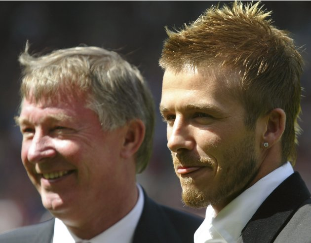 File photo of Manchester United's David Beckham standing with manager Sir Alex Ferguson before their match against Charlton Athletic in the English premier league match at Old Trafford