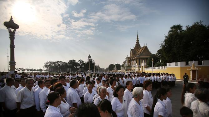 Thousands of mourners gather at the Royal Palace and wait in line to pay their respects to the late former Cambodian King Norodom Sihanouk in Phnom Penh, Saturday, Feb. 2, 2013. Sihanouk's body had been lying in state at the Royal Palace after being flown from Beijing where he died Oct. 15 of a heart attack at the age of 89. The cremation, the climax of seven days of mourning, will take place Monday.(AP Photo/Wong Maye-E)