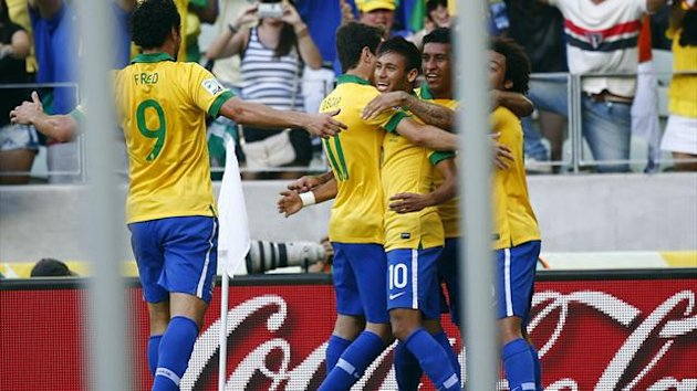 Brazil's Neymar (C) celebrates his goal against Mexico with teammates during their Confederations Cup Group A match (Reuters)