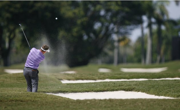 Britain's Luke Donald hits from a bunker on the second hole during second round play in the 2013 WGC-Cadillac Championship PGA golf tournament in Doral