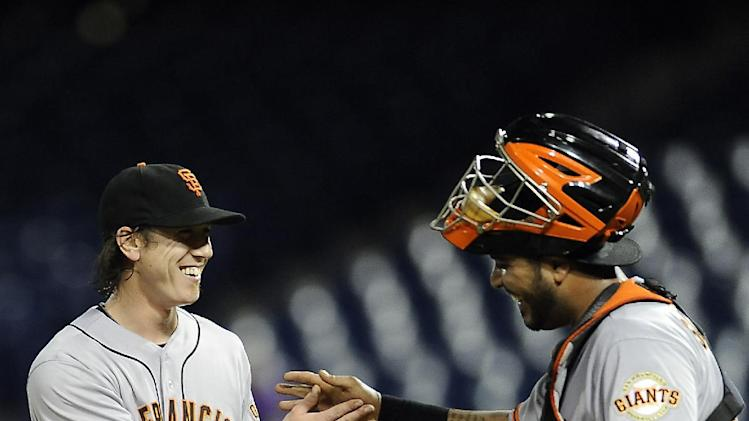 San Francisco catcher Hector Sanchez, right, celebrates with pitcher Tim Lincecum at the end of fourteen innings of a baseball game against the Philadelphia Phillies on Wednesday, July 23, 2014, in Philadelphia. The Giants beat the Phillies 9-6 in extra innings. (AP Photo/Michael Perez)