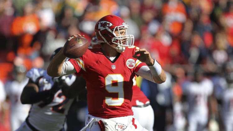 Kansas City Chiefs quarterback Brady Quinn (9) passes to a teammate during the first half of an NFL football game against the Denver Broncos at Arrowhead Stadium in Kansas City, Mo., Sunday, Nov. 25, 2012. (AP Photo/Ed Zurga)