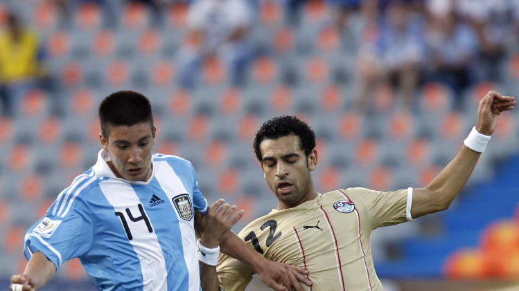 Argentina's Adrian Martinez and Egypt's Mohamed Salah fight for the ball during a U-20 World Cup round of 16 soccer match in Medellin, Colombia, Tuesday, Aug. 9, 2011. (AP Photo/Ricardo Mazalan)