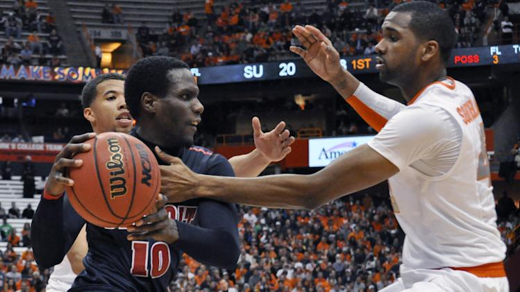 Detroit's Jason Calliste is pressured by Syracuse's James Southerland, right, and Michael Carter-Williams during the first half of an NCAA college basketball game in Syracuse, N.Y., Monday, Dec. 17, 2012. (AP Photo/Kevin Rivoli)