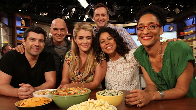 """This Friday, Aug. 26, 2011 photo shows, from left to right, Danny Boome, Iron Chef Michael Symon, Daphne Oz, Clinton Kelly, Evette Rios and Carla Hall as they pose for a photograph following a rehearsal of ABC's """"The Chew"""" in New York. Symon, Oz, Kelly and Hall are co-hosts of the show.  Boome and Rios are the show's correspondents. Can some of food and style TV's biggest stars help ABC soap fans get over cancellation of their favorite stories? The network's counting on it for """"The Chew.""""     (AP Photo/Tina Fineberg)"""