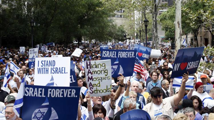 People hold signs during a pro-Israeli demonstration near the United Nations in midtown Manhattan in New York City