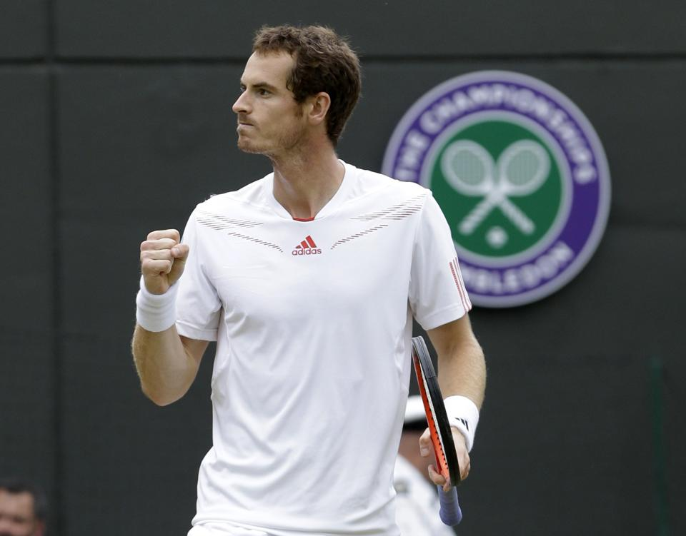 Andy Murray of Britain reacts after defeating Marin Cilic of Croatia during a fourth round singles match at the All England Lawn Tennis Championships at Wimbledon, England, Tuesday, July 3, 2012. (AP Photo/Kirsty Wigglesworth)