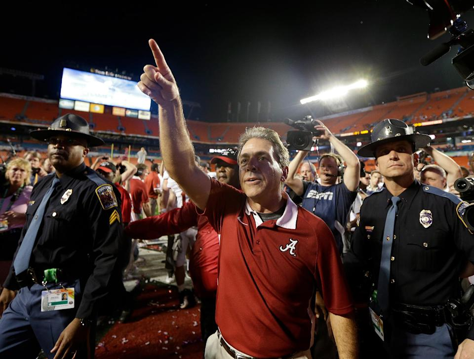 Alabama head coach Nick Saban acknowledges the fans after the BCS National Championship college football game against Notre Dame Monday, Jan. 7, 2013, in Miami. Alabama won 42-14. (AP Photo/David J. Phillip)