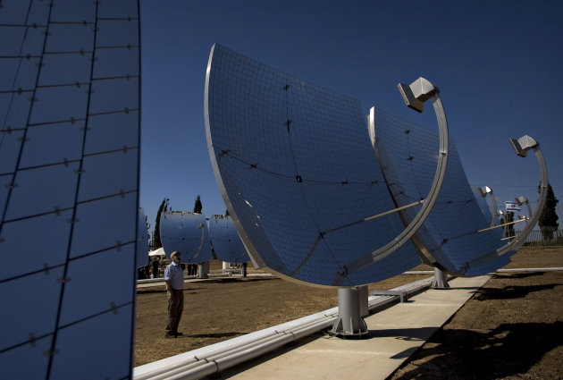 FILE - In this April 26, 2009 file photo, solar dishes are seen at a solar farm, which according to the manufacturer, are revolutionary in the way they efficiently produce maximum energy using a minimal area, in Kibbutz Kvutzat Yavne, Israel. Israel has a peak solar capacity of 212 megawatts, the vast majority of which comes from rooftop installations, that accounts for less than 2 percent of the nationwide capacity according to the government-owned Israel Electric Corporation. (AP Photo/Sebastian Scheiner, File)