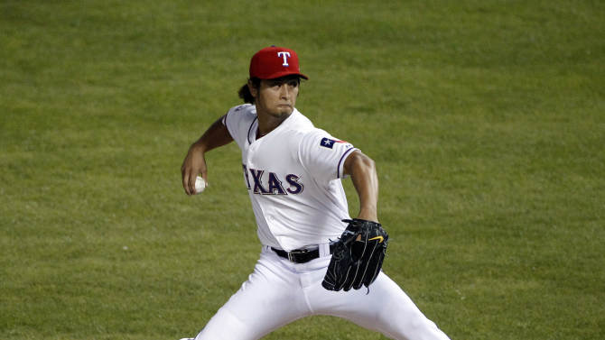 Texas Rangers starting pitcher Yu Darvish throws to a Baltimore Orioles batter during the first inning of an American League wild-card playoff baseball game Friday, Oct. 5, 2012, in Arlington, Texas.(AP Photo/Tony Gutierrez)