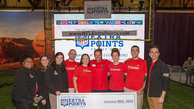 IMAGE DISTRIBUTED FOR BARCLAYCARD - Chicago Bears kicker Jay Feely, (4th from the right) presents 1.5 million NFL Extra Points, ($15,000) to the Pat Tillman Foundation Scholars at the NFL Extra Points Card Charity Kick, Wednesday, Jan. 28, 2015 in Phoenix. (AP Photo/Jeff Lewis for Barclaycard)