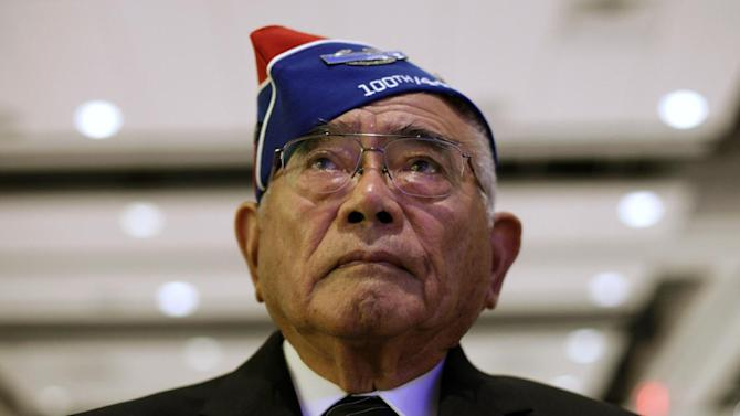 World War II veteran Don S. Miyada of Westminster, Calif., looks to the stage during a ceremony in honor of Japanese American World War II veterans of the 100th Infantry Battalion, 442nd Regimental Combat Team at the Washington Hilton in Washington, Tuesday, Nov. 1, 2011. Nearly seven decades after Pearl Harbor, Congress is honoring Japanese-American military units that helped the United States win World War II on two fronts despite the hardships endured by many troops' families back home.  (AP Photo/Carolyn Kaster)