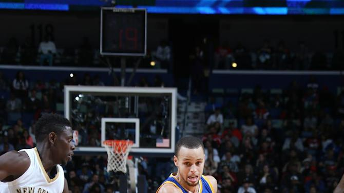 Curry lifts Warriors past Pelicans 128-122 in OT