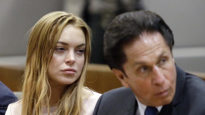 Actress Lindsay Lohan, left, and her attorney Mark Heller appear at a hearing in Los Angeles Superior Court, Monday, March 18, 2013. Lohan accepted a plea deal on Monday in a misdemeanor car crash case that includes 90 days in a rehabilitation facility. The actress, who has struggled for years with legal problems, pleaded no contest to reckless driving, lying to police and obstructing officers who were investigating the accident involving the actress in June. (AP Photo/Reed Saxon, Pool)