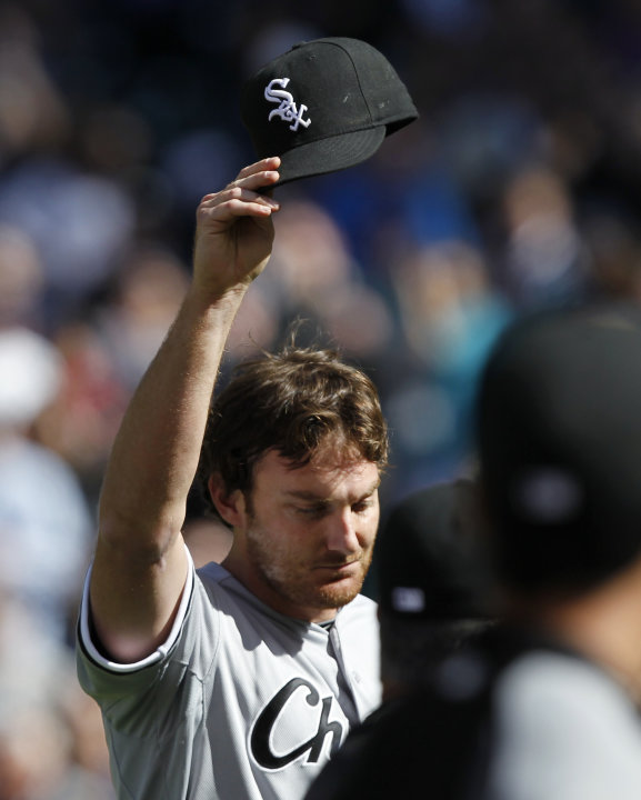 Chicago White Sox starting pitcher Phil Humber waves his cap after pitching a perfect baseball game against the Seattle Mariners, Saturday, April 21, 2012, in Seattle. The White Sox won 4-0. (AP Photo