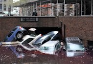 Picture taken October 31, 2012 in New York shows cars piled on top of each other at the entrance to a garage in Lower Manhattan after superstorm Sandy. A government report warned the United States could face more frequent severe weather including heat waves and storms for decades to come as temperatures rise far beyond levels being planned for