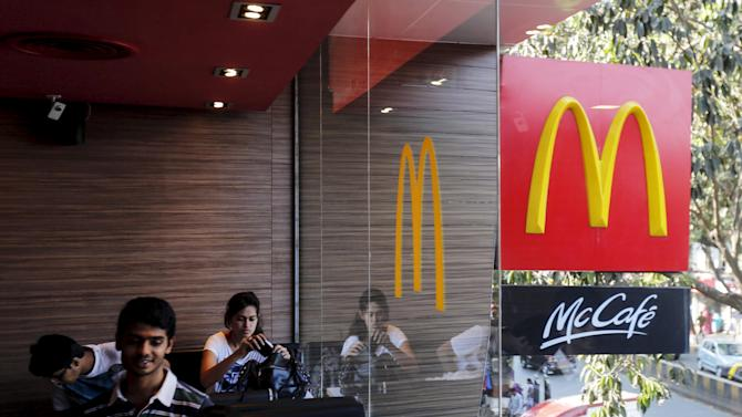 File picture shows visitors sitting at a McDonald's restaurant in Mumbai