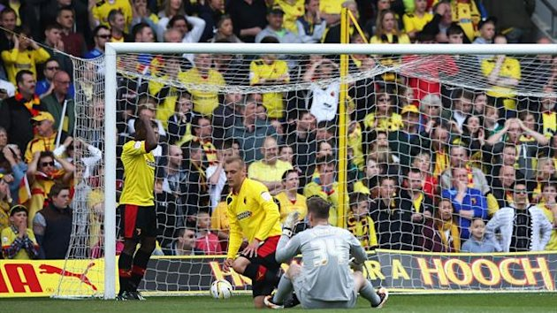 Substitute goalkeeper Jack Bonham of Watford sits on the ground dejected after the opening goal scored by Dominic Poleon of Leeds United during the npower Championship match between Watford and Leeds United at Vicarage Road on May 4, 2013 (Getty)