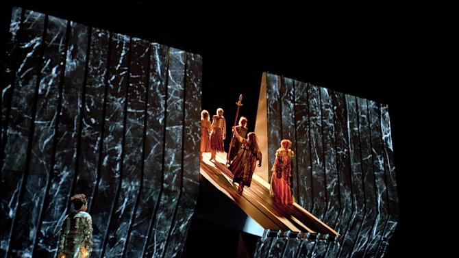 """This March 30, 2012 photo provided by the Metropolitan Opera shows a scene from Wagner's, """"Das Rheingold,"""" during a dress rehearsal at the Metropolitan Opera in New York. On May 12 the Met concludes the last of three complete presentations of Robert Lepage's production of the four-opera Ring Cycle, which includes Das Rheingold; Die Walkure; Siegfried and Gotterdämmerung. (AP Photo/The Metropolitan Opera, Ken Howard)"""