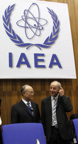 Director General of the International Atomic Energy Agency, IAEA, Yukiya Amano, left, from Japan and Denis Flory, right, from France, deputy director general and head of the department of nuclear safety and security, wait for the start of the IAEA's Parties to Nuclear Safety Convention Hold Review at the International Center in Vienna, Austria, on Monday, April 4, 2011. Amano said the Japanese nuclear crisis presents a major challenge and has enormous implications for nuclear power. (AP Photo/Ronald Zak)