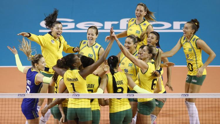 Players of Brazil celebrate their victory over Russia during their FIVB Women's Volleyball World Grand Prix 2014 final round match in Tokyo