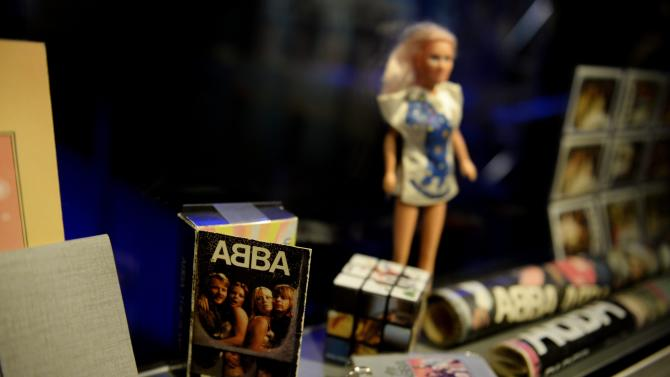 """Swedish music group ABBA memorabilia seen during a press preview of 'ABBA The Museum' at the Swedish Music Hall of Fame in Stockholm, Sweden, Monday May 6, 2013. A museum opens in Stockholm on Tuesday to show off band paraphernalia, including the helicopter featured on the cover of their """"Arrival"""" album, a star-shaped guitar and dozens of glitzy costumes the Swedish band wore at the height of its 1970s fame. (AP Photo/Scanpix Sweden/Jessica Gow) SWEDEN OUT"""