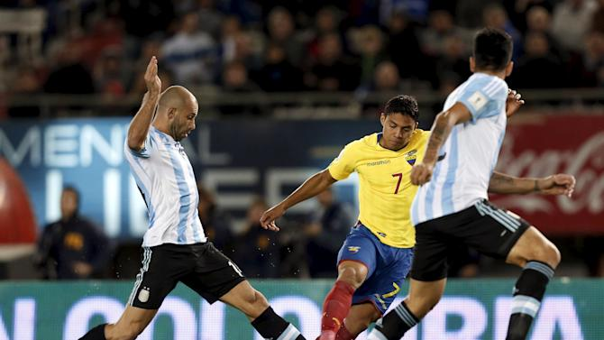 Ecuador's Montero dribbles the ball under pressure from Argentina's Mascherano and Garay during their 2018 World Cup qualifying soccer match in Buenos Aires, Argentina