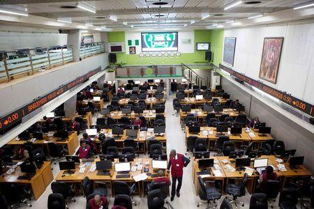 Traders work at the Nigerian Stock Exchange in Lagos