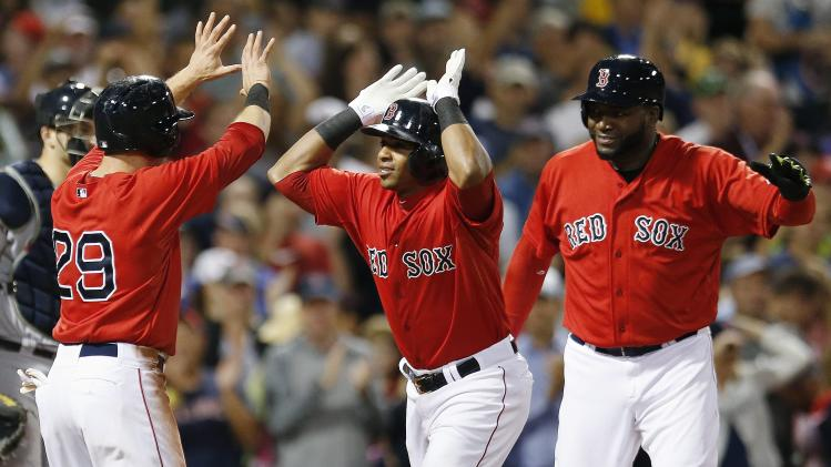 Boston Red Sox's Yoenis Cespedes, center, celebrates his three-run home run, that also drove in Daniel Nava (29) and David Ortiz, right, during the sixth inning of a baseball game against the Seattle Mariners in Boston, Friday, Aug. 22, 2014. (AP Photo/Michael Dwyer)