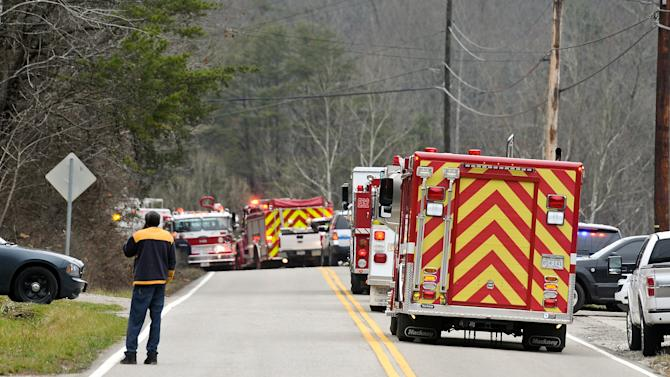 Emergency vehicles from every agency aailable line the roadway of Route 21 in between Sissonville, W.V., and Pocatalico, W.V., Tuesday Dec. 11, 2012, after a natural gas line explosion.   At least five homes went up in flames Tuesday afternoon and a badly burned section of the expressway in West Virginia was closed after a natural gas line exploded in an hour-long inferno.  (AP Photo/Charleston Daily Mail, Bob Wojcieszak)