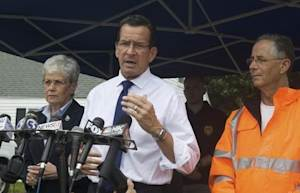 Connecticut's Governor Dannel Malloy speaks to the media in East Haven, August 9, 2013.
