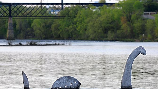 FILE - In this Monday, April 30, 2012 file photo, a sculpture resembling the Loch Ness monster rises out of the Chippewa River in Eau Claire, Wis. The Wisconsin Department of Natural Resources views the sculpture as an illegal obstruction to a navigable waterway and wants it removed.  A person claiming to be the creator emailed the Eau Claire Leader-Telegram Thursday, May 3, 2012 and said the sculpture would be removed in the next 10 days.  (AP Photo/Eau Claire Leader-Telegram, Dan Reiland, File)