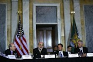 <p>Federal Reserve Board Chairman Ben Bernanke (2nd L) speaks July 18 at the Treasury Department in Washington, DC. The Federal Reserve's top policy makers are expected to shy away from taking new economic stimulus measures when they meet Tuesday and Wednesday, instead waiting until the economic picture becomes clearer.</p>