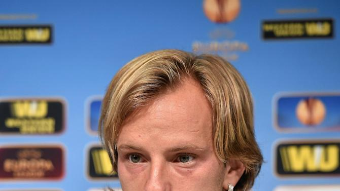 In this photo made available by Uefa, Sevilla FC captain Ivan Rakitic  talks during a press conference ahead of tomorrow's final of the Europa League against Benfica, at the Juventus stadium in Turin, Italy, Tuesday, May 13, 2014 ( AP Photo/Uefa, HO)