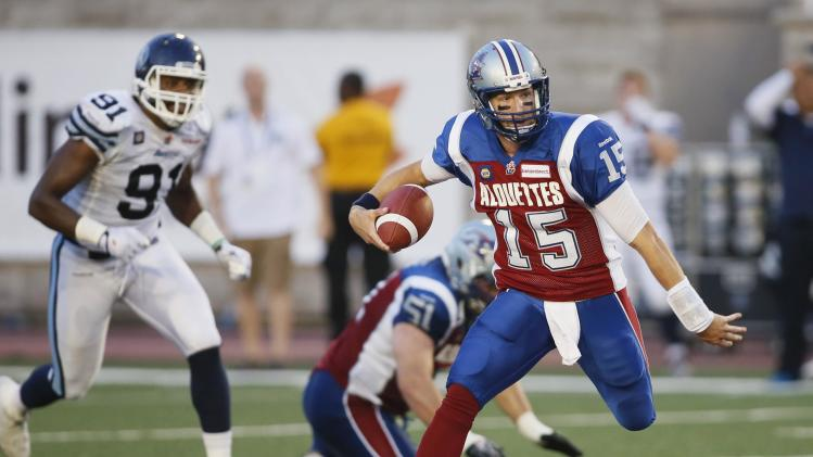 Montreal Alouettes' quarterback Alex Brink runs with the ball during first half CFL football action against Toronto Argonauts in Montreal