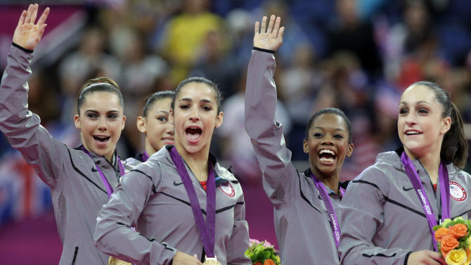 U.S. gymnasts, left to right, McKayla Maroney, Kyla Ross, Alexandra Raisman, Gabrielle Douglas and Jordyn Wieber celebrate during the medal ceremony of the Artistic Gymnastics women's team final at the 2012 Summer Olympics, Tuesday, July 31, 2012, in London.  U.S. won the gold. (AP Photo/Julie Jacobson)