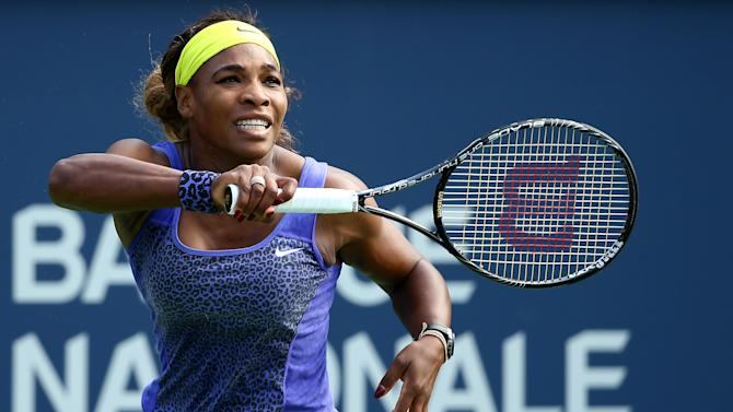 Serena Williams of the USA returns a shot to Lucie Safarova of the Czech Republic during the Rogers Cup at Uniprix Stadium on August 7, 2014 in Montreal, Canada