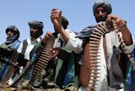Ex-Taliban fighters display their weapons as they join Afghan government forces during a ceremony in Herat province in April 2012. Afghan government representatives have held secret talks with a key member of the Taliban held in a Pakistani jail officials said Monday -- a move that could signal fresh hope for peace negotiations