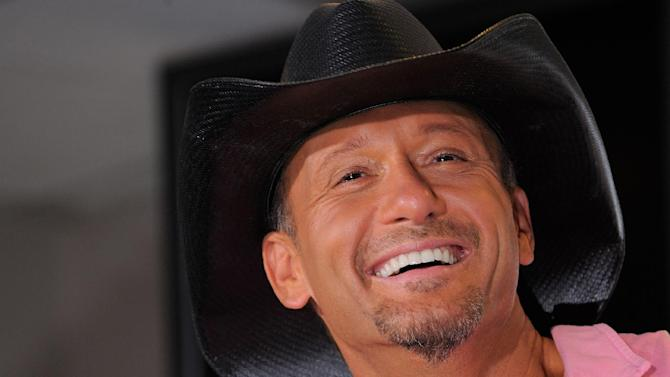 """Country singer Tim McGraw appears at a news conference to promote his """"Brothers of the Sun"""" concert tour on Friday June 1, 2012 in Tampa, Fla. McGraw and fellow country singer Kenny Chesney will kick off their joint tour on Saturday night in Tampa, Fla. (Photo by Scott Miller/Invision/AP)"""