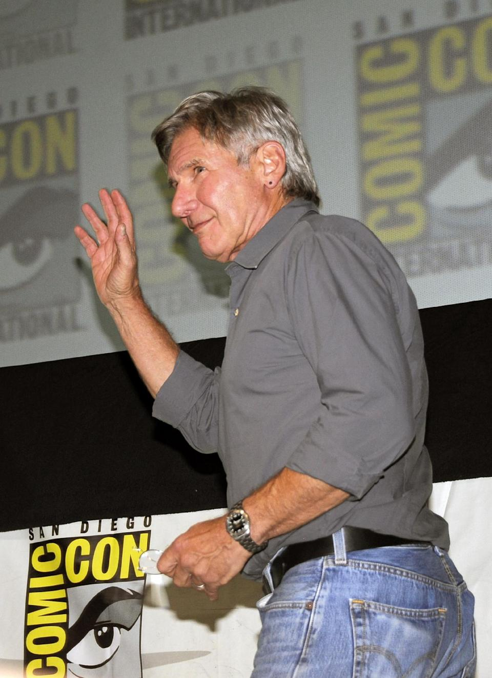 "Actor Harrison Ford walks onto stage at the ""Ender's Game"" panel on Day 2 of the 2013 Comic-Con International Convention on Thursday, July 18, 2013 in San Diego. (Photo by Denis Poroy/Invision/AP)"
