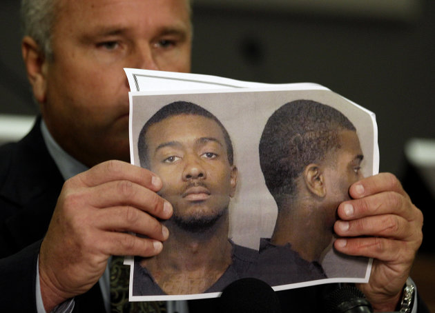 Auburn Police Chief Tommy Dawson holds up a photo of Desmonte Leonard, 22, of Montgomery, Ala., the suspect wanted for fatally shooting three people, including two former Auburn University football players, and wounding another three people during a party at an apartment complex near the school, at a news conference Sunday, June 10, 2012, in Auburn, Ala. Dawson said that current football player Eric Mack was among those wounded and was being treated at a hospital. The two slain former players were identified as Edward Christian and Ladarious Phillips. The other person killed was identified as Demario Pitts. (AP Photo/David Goldman)