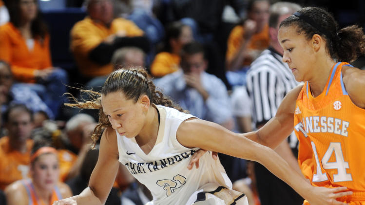 Tennessee's Andraya Carter, right, pressures Chattanooga's Alex Black during their NCAA college basketball game, Friday, Nov. 9, 2012, in Chattanooga, Tenn. (AP Photo/Chattanooga Times Free Press, Angela Lewis) THE DAILY CITIZEN OUT; NOOGA.COM OUT; CLEVELAND DAILY BANNER OUT; LOCAL INTERNET OUT; MANDATORY CREDIT