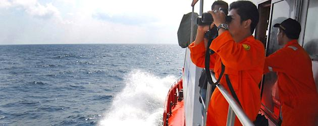 A member of Indonesian National Search and Rescue Agency scan the horizon. (Heri Juanda/AP)