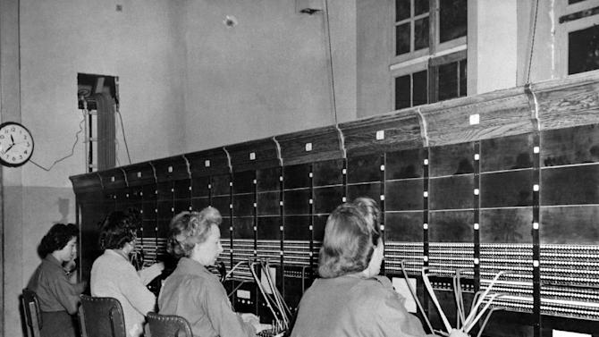 FILE - In this Oct. 7, 1944, file photo provided by the U.S. Army Signal Corps, Women Army Corps (WAC) switchboard operators put military calls through at their base in France. (AP Photo/U.S. Army Signal Corps)