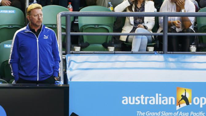 Boris Becker, former tennis player and the coach of Novak Djokovic of Serbia, watches the men's singles quarter-final match between Djokovic and Milos Raonic of Canada at the Australian Open 2015 tennis tournament in Melbourne