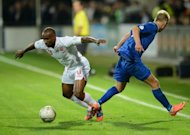 Jermain Defoe (L) of England fights for the ball with Suvorov Alexandru of Moldova during their World Cup 2014 qualifier in Chisinau. England won 5-0