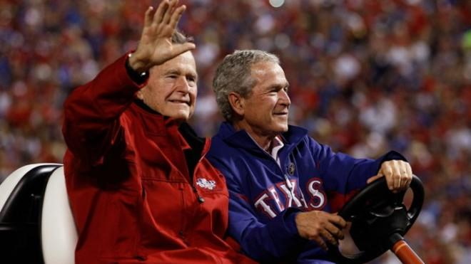 Long before illness and privacy breaches, father and son enjoy a 2010 Texas Rangers game.